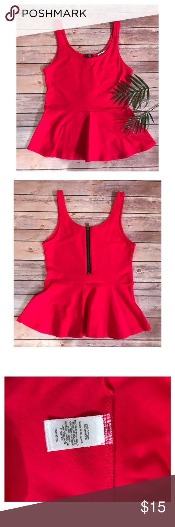 EXPRESS Hot Pink Peplum Top Express hot pink Peplum top! Zips down the back. Worn one time and washed. Very stretchy! Let me know if you have any questions prior to purchasing! 🤗💕 Express Tops Tank Tops
