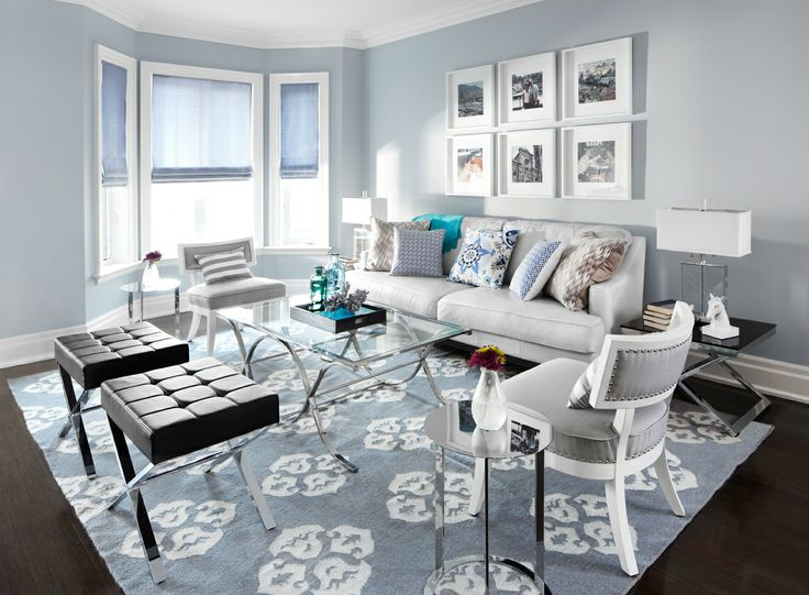 Contemporary Living Room With Blue Walls And Area Carpet, White Sofa, Black  Ottomans And