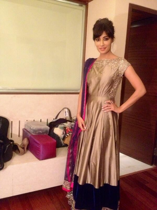 Chitrangada Singh in MM.  shirt in rust golden with a colorful dupatta