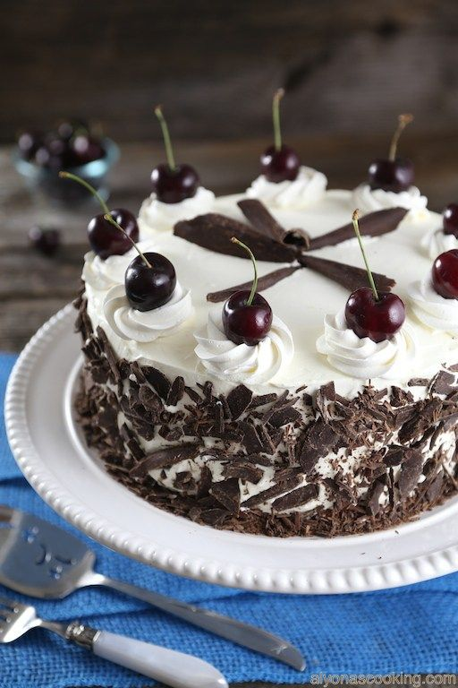 A black forest chocolate cake usually consists of several soaked sponge cake layers that are sandwiched between whipped cream and cherries, then decorated with additional whipped cream and chocolat…