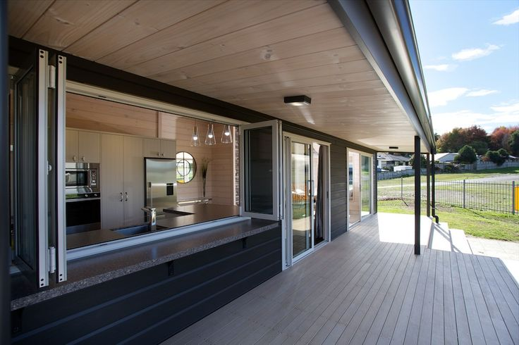 Lockwood Taupo show home with blonded soffits and great access to the kitchen from the bifold windows