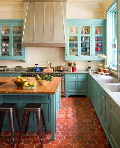 dream kitchen: marble counter, butcher block island, glass-front cabinets & Tiffany blue!