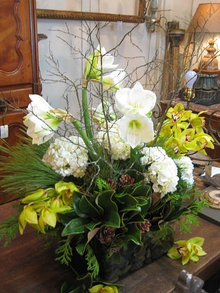 Arrangement with Amaryllis, Hydrangea, Orchids, Pinecones and Magnolia Leaves