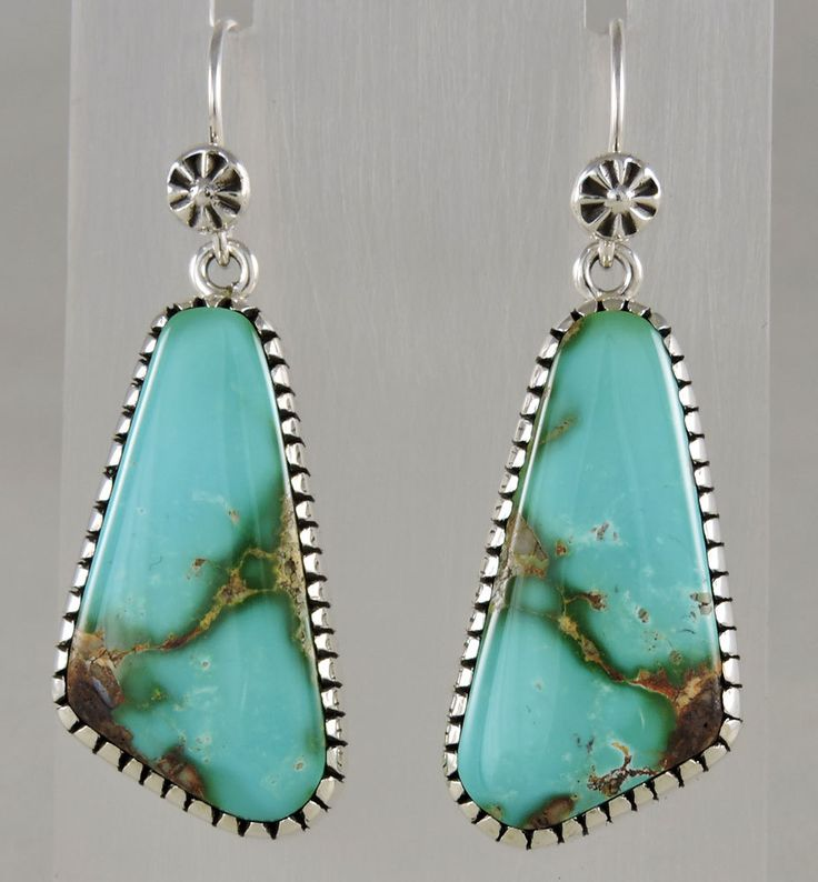 """1 1/2"""" long sets dangle from his hand made wires, total length is 2"""". There is some weight, but they don't pull on the ear. Gorgeous color like the Caribbean Sea."""