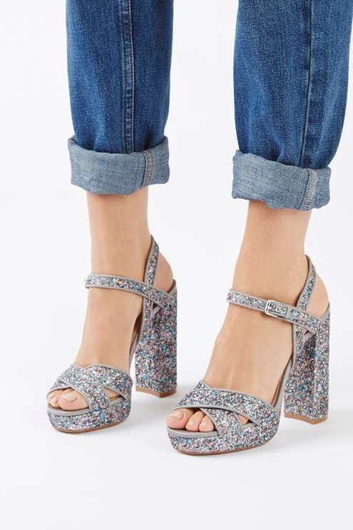 Walk tall in these glitter platform sandals, featuring a cross toe strap and chunky heel. A wardrobe must-have, we'd wear these with a black midi dress for a stand-out, contrasting look. #Topshop