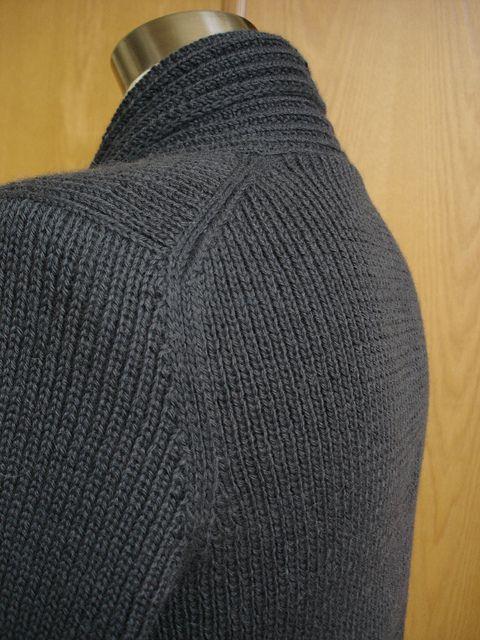 Knitter calls this European Shoulder Seam (lined up along back, and not top of shoulder). Tres Elegant!