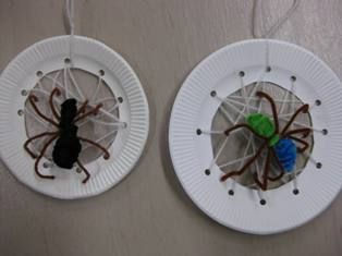 Paper Plate Spider Web - We had small colorful plastic spiders from Oriental Trading Co. that we glued in the web.  The kids loved this!