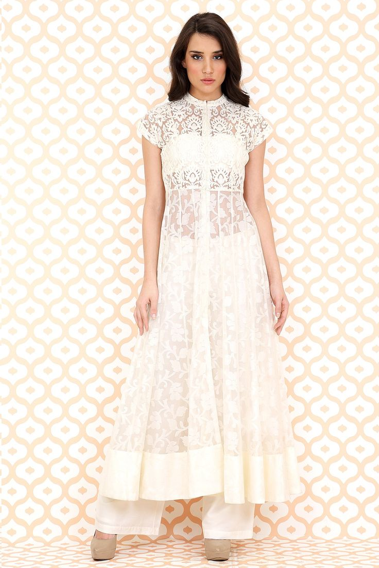 DESCRIPTION:Featuring a beautiful cream Chinese collar cap sleeved net brocade open anarkali jacket set is teamed with white cotton silk pants.COMPOSITION:Jacket – 50% nylon 50% viscosePants – 80% viscose 20% polyesterMEASUREMENTS:SIZE XS: BUST:33