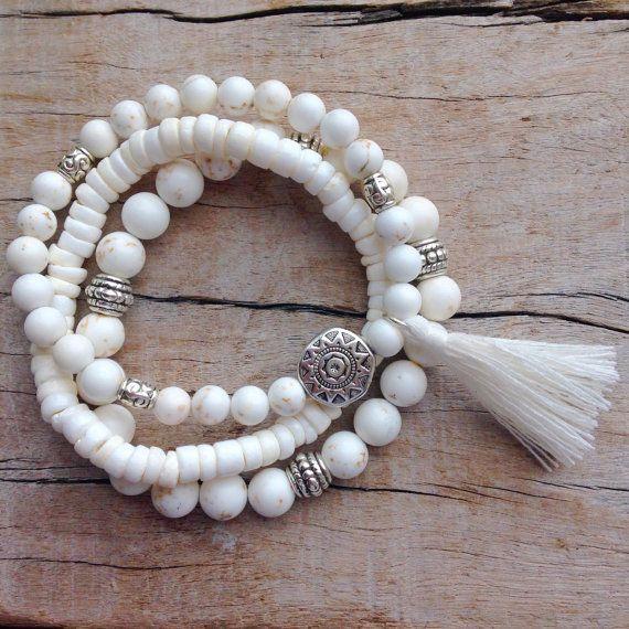 3 white bohemian bracelets  1. white howlite with silver Tibetan style beads and a white cotton tassel 2. puka shell 3. white howlite with silver
