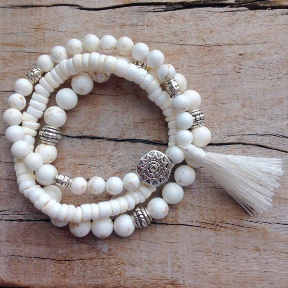 3 white bohemian bracelets 1. white howlite with silver Tibetan style beads and a white cotton tassel 2. puka shell 3. white howlite with silver