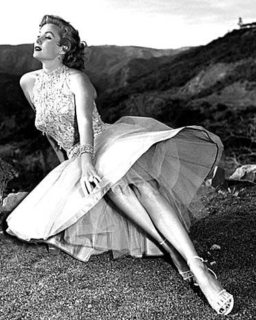 Rhonda Fleming (born Marilyn Louis in Hollywood, California, August 10, 1923), is an American film and television actress. She acted in more than forty films, mostly in the 1940s and 1950s, and became renowned as one of the most beautiful and glamorous actresses of her day