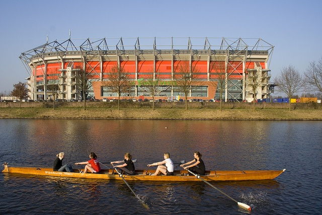 Students rowing on the Twentekanaal, past the Grolsch Veste; the stadium of football club FC Twente.