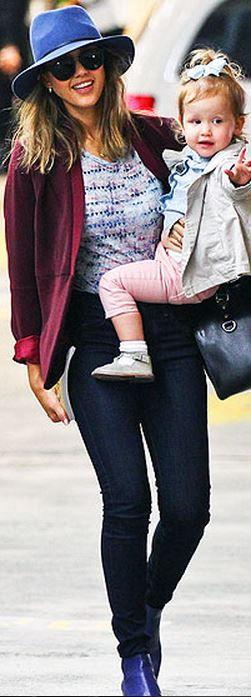 Who made  Jessica Alba's purple blazer, black handbag, and print top?