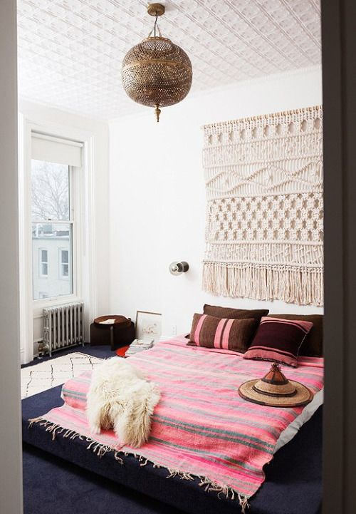Simple yet beautiful bedroom idea.   A hint of southwest bohemian charm.