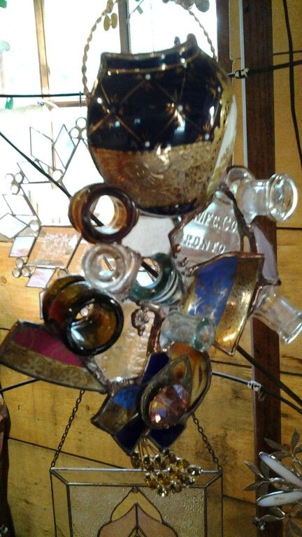 Old bottle tops and broken china, by suzanne muir
