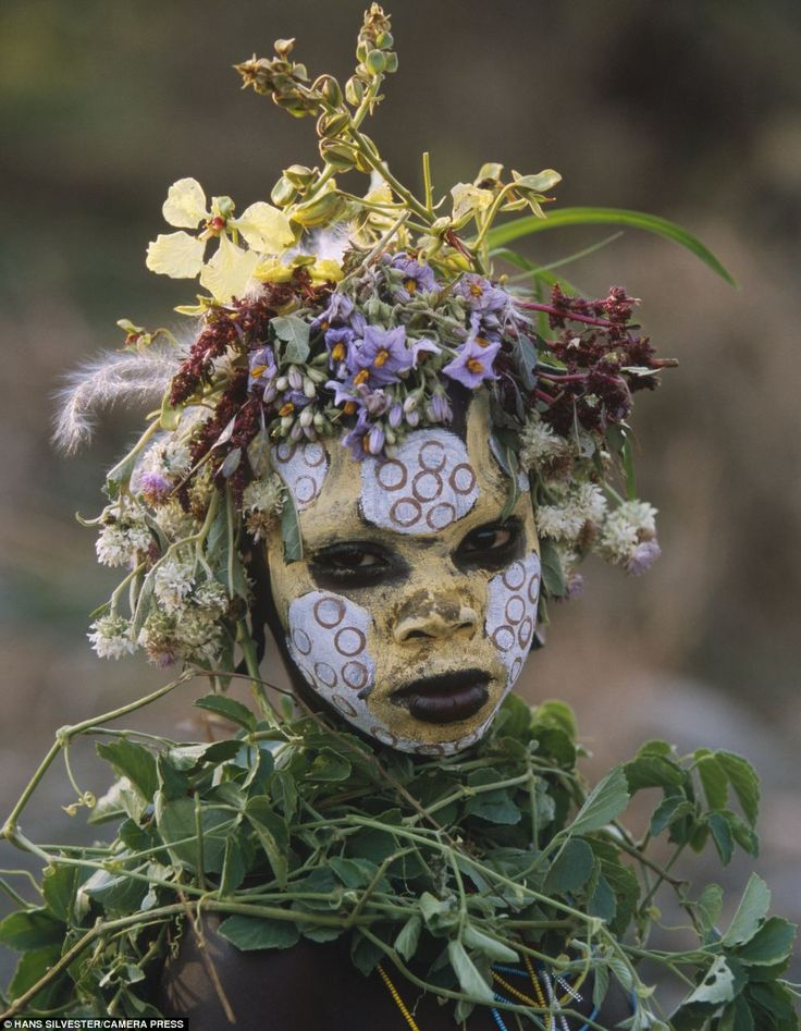 Fantastic collection of photos of the Omo tribel - Celebration: Photographer Hans Silvestre described the paint and head dresses worn by his subjects as a 'kind of coquetry, seduction, pride and celebration'