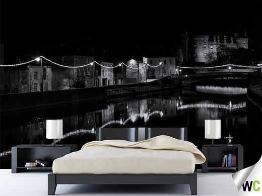 Black and white mural of Kilkenny city, Ireland, at night time.