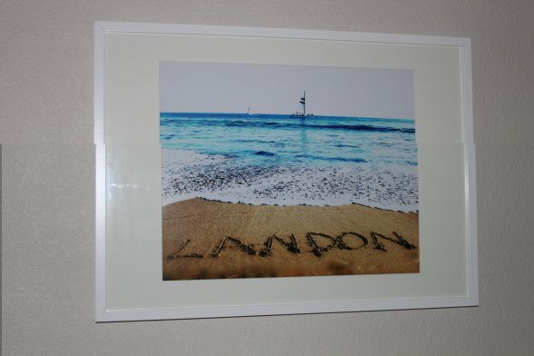 This is something that is so personal and beautiful and inexpensive. Write your little guy's name in the sand, take a photo, have it blown up and framed! If you want your photo edited to look more professional you could send it to me and I would love to do that for you!