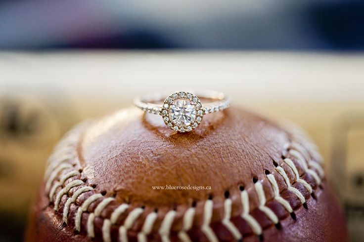 Gorgeous engagement ring shot on a baseball!  #BlueRoseDesigns #engagement #engaged #engagementphotography #esession #engagmentsession #engagementphoto #shesaidyes #windsorweddings #windsorweddingphotographer #engagementring #baseball #ring #londonontario #bluejays #torontobluejays