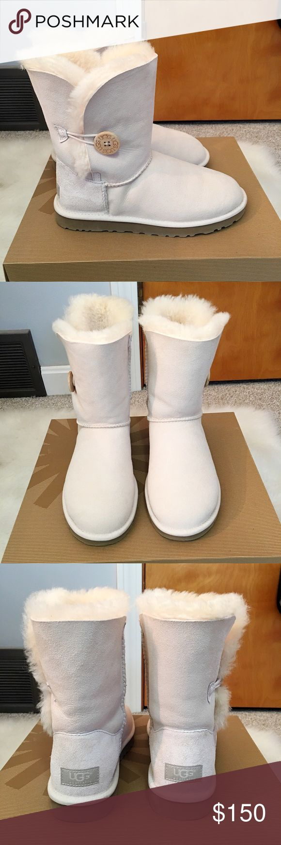 Ugg Bailey Button Boots in White/Cream Ugg Bailey Button Boots in White/Cream Size 7, worn once to try them on (not outside). As you can see by the bottom of the boots, they are in perfect condition. The color is a creamy white. I also treated them with the Ugg Water/Stain Repellent protective spray. Comes with original box UGG Shoes Winter & Rain Boots