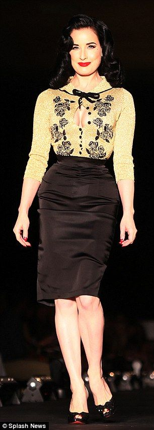 Racy: The entrepreneur wore the limited edition Dita Gold Cardigan from the new collection...