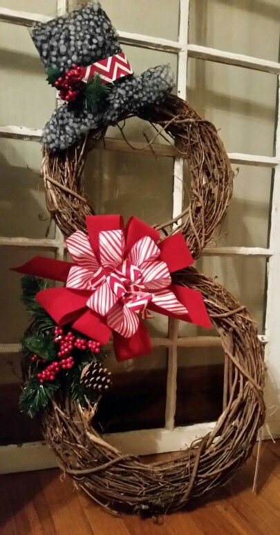 My snowman made of grapevine wreaths with red ribbon, great for Christmas and all winter.