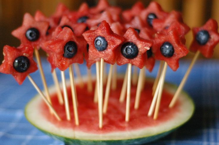 Star watermelon cutouts with a blueberry center... on sticks-such a sweet-when-seasonably-ripe treat:) Happy 4th of July, U.S. of A.cans!
