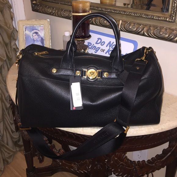 100% Authentic Versace Duffle Bag 100% Authentic Versace Duffle Bag. Black leather with gold hardware. Never been used, brand new. You'll never find these bags ever!!! Versace Bags Travel Bags