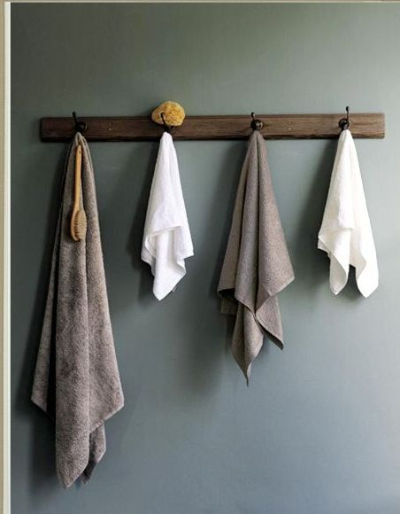 i think i like the idea of hooks for towels in the bathroom rather than a towel rack.  looks neater.
