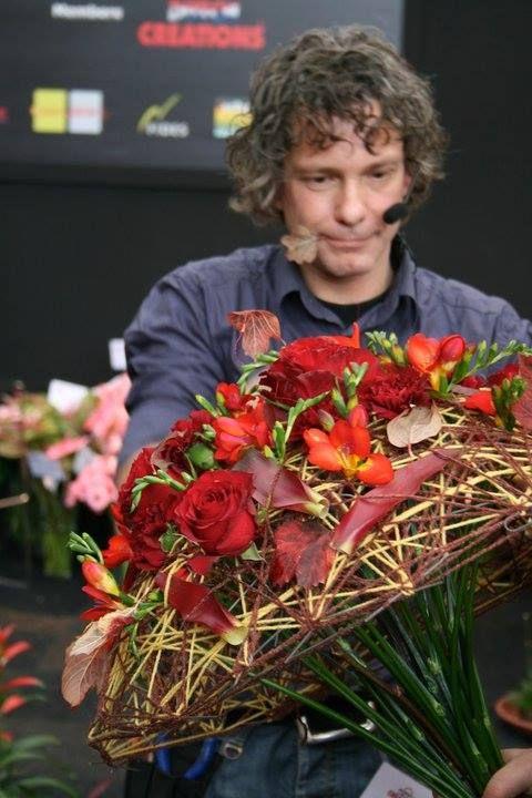 arranging loose flowers into bouquet