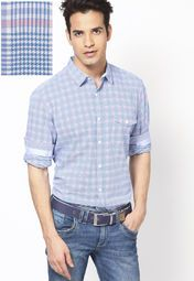Look smart and dashing by wearing this trendy shirt by United Colors of Benetton that exhibits an interesting interplay of pink, white and other hues. The stunning check pattern further infuses more sophistication into this shirt. Tailored in regular-fit from fine cotton, it will keep you at ease all day long.