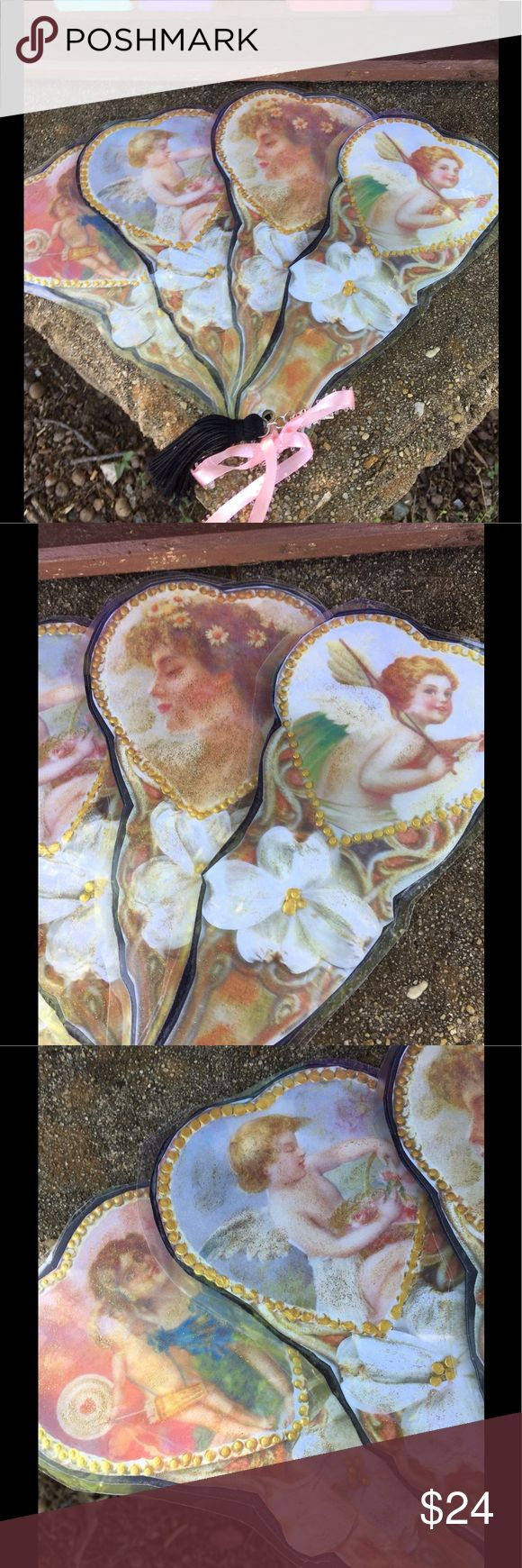 Victorian Tassled Cherub Dogwood Hand Fan Well I got the idea to make these when I saw these beautiful pics online and went from there. I used glitter and gold highlights and added a Tassle with ribbon and laminated. Will be listing many more including a cat, butterfly, birdcages, etc. Measures about 8 x 10 when open. Scanned dogwood flowers. Please no lowball offers as it cost money for all my supplies especially all the ink to print! They make lovely gifts and from what I have seen are…