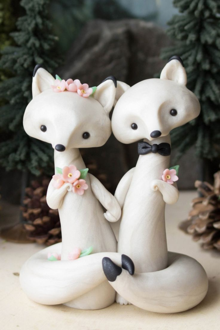 3. These arctic foxes from BonjourPoupette are must-have adorable! See all 20 wedding cake toppers we love here!