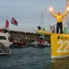 British woman Dee Caffari, onboard Aviva, celebrates as she sets a new world record sailing non stop both ways around the world 2009