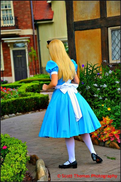 Alice looking for a white rabbit in Epcot's United Kingdom pavilion, Walt Disney World, Orlando, Florida
