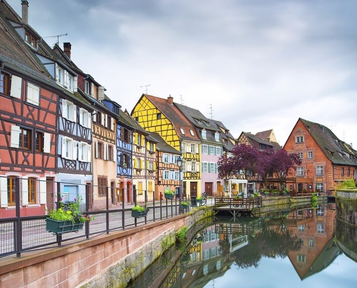 "Colmar, France is like the ""disney princess of towns,"" complete with ""tiny boats adrift in flowery canals, a miniature train chugging whimsically ar..."