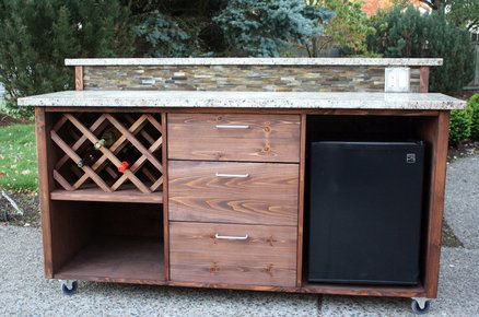 Outdoor bar with wine bar, refrigerator and counter. Love the portability with the wheels.