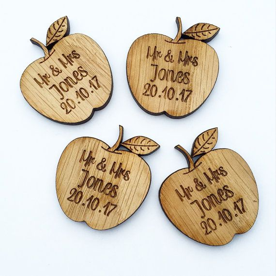 These cute little apples are inspired by the beauty of true love, these handcrafted apple decorations capture the magic of a wedding in a lasting keepsake. Ideal for table décor, reception hall decorations, or as rustic wedding favors these personalised apples are as sweet as your first kiss. These decorations are available in quantities of 100 or 200.  Each Oak finished wood apple measures 4 mm thick and approximately 3.5 x 3.5 cm (1.4 inches by 1.4 inches).  In the Notes to Seller portion…