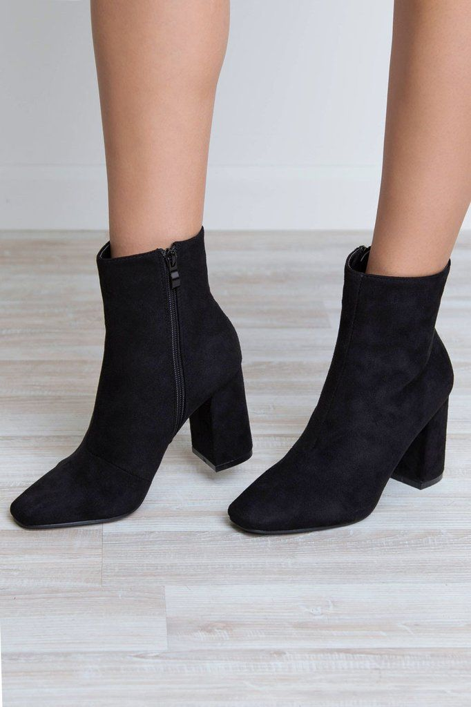 Walk the walk and talk the talk! These Walk And Talk Suede Boots features a black sueded material, side-zip closure, and a sueded covered stacked heel. Square toe. Above ankle styling. Cushioned insol