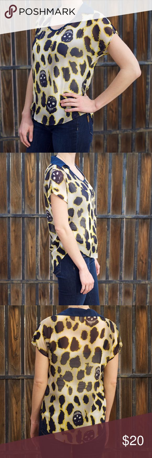 Sheer Collared Skull and Cheetah Print Blouse Teenplo flowy sheer blouse with skull and cheetah print pattern. Navy, yellow, and white design with navy collar. Seen worn with a gray cami underneath. 100% polyester. Fits like a women's size S. Gently worn, no tears, holes, or stains. Teenplo Tops Blouses