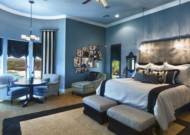 deluxe bedroom design with high luxury headboard and twin striped blue benches and unique crystal pendant lamps also blue framed rug and blue wall paints