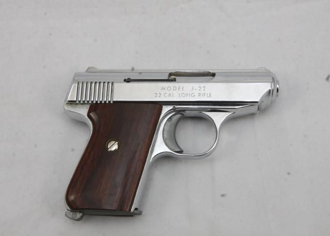 Jennings model J-22 semi automatic striker fired pistol chambered in .22 Long Rifle, with wood grips. Serial number 392591.