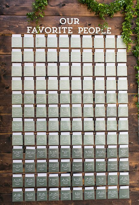 Create an ombré seating chart on a rustic wooden backdrop, starting with the lightest cards on top and gradually getting darker.