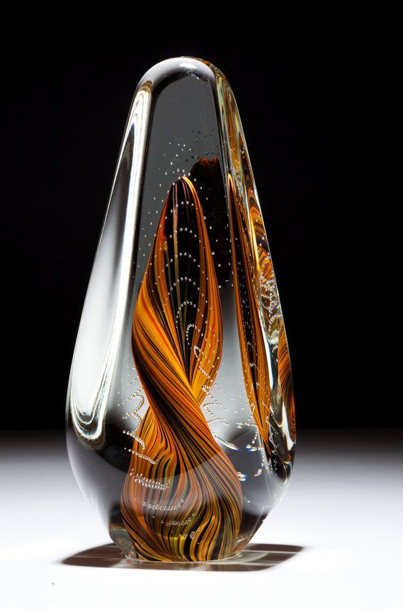 A beautiful glass art sculpture hand blown in orange and blue by Scott Hartley of Infinity Art Glass
