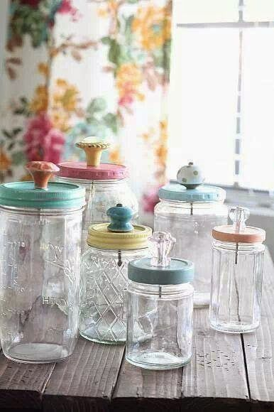 Recycled glass jars with knobs on the lids.
