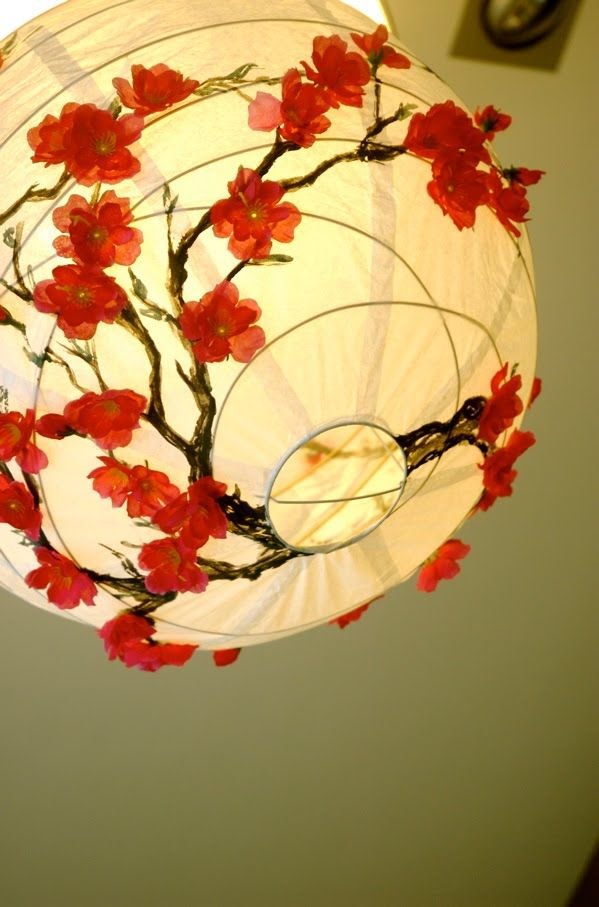 Cherry Blossom Lantern Tutorial from the IKEA Hackers site, where they make all kinds of stuff from plain IKEA products. Seem do-able, and I even have the extra shade...