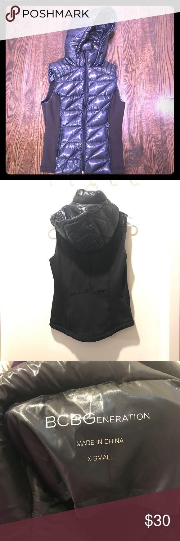 BCBGeneration Down Vest - NWOT! Navy and black down vest. Has hood and 2 front zip pockets.   Down front, polyester/spandex back. BCBGeneration Jackets & Coats Vests