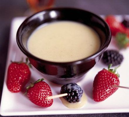 Divine white chocolate fondue in which to dip summer fruits