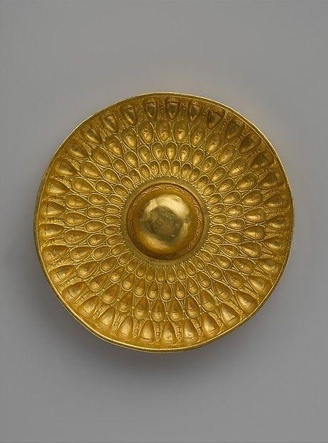 Gold phiale (libation bowl) Period: Late Classical or Hellenistic Date: 4th–3rd century B.C. Culture: Greek Medium: Gold Dimensions: H. 1 7/16 in. (3.6 cm); diameter 9 1/4 in. (23.5 cm)