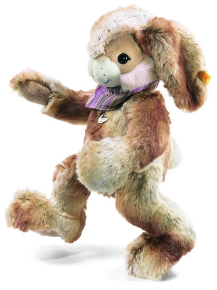 """Material: Made of cuddly soft woven fur Size: 17.7 inches Color: Beige Eyes: Safety eyes Ear tag: Yellow tag; brass-plated """"Button in Ear"""" Joints & Pose: Not jointed Sound device: None Care: Machine washable at 86°F (30°C) Country of origin: Made in Tunisia"""